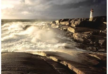 Waves crashing against rocks, Peggy's Cove Lighthouse